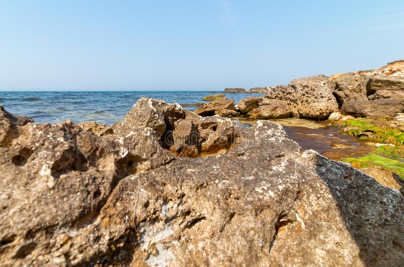 Beautiful ruined rocks on the seashore. Natural landscape stock images