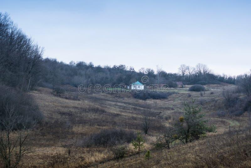Beautiful rural landscape. Old traditional ukrainian house in Poltava region, Ukraine royalty free stock images