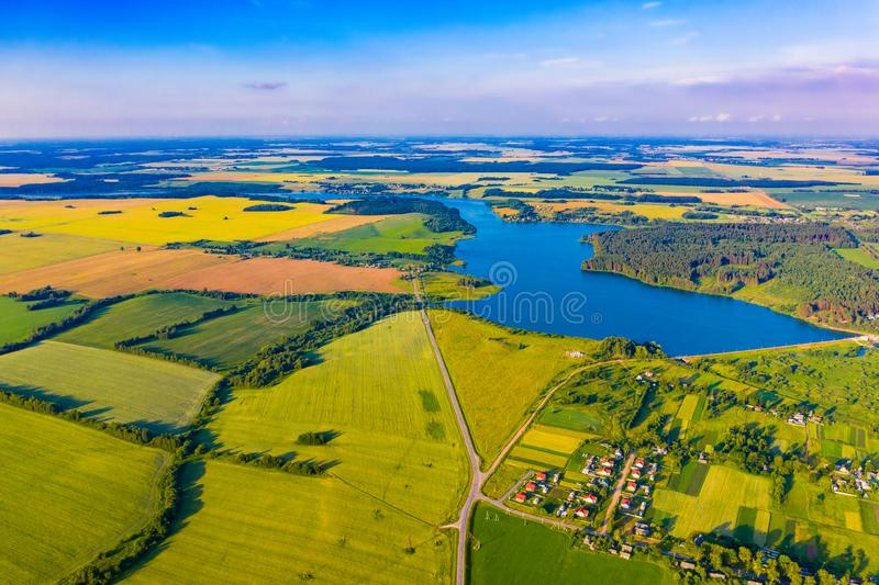 Beautiful rural landscape. Pure nature concept. Blue lake and bright fields, aerial scenery stock photos