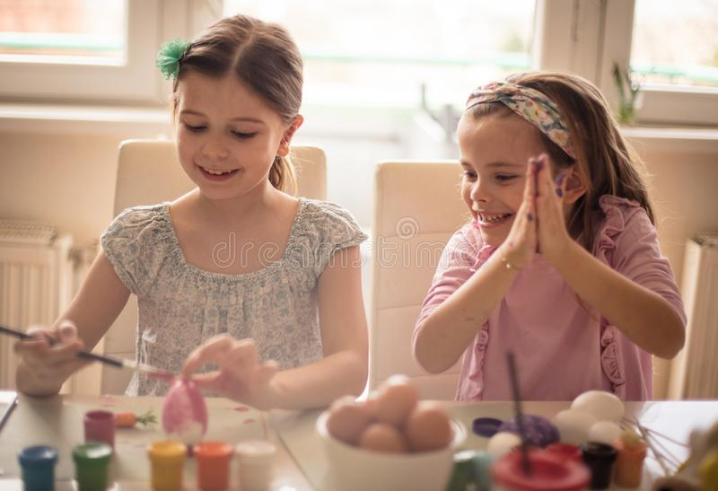 Beautiful, it`s a wonderful Easter happy egg. Little girls coloring Easter egg stock images