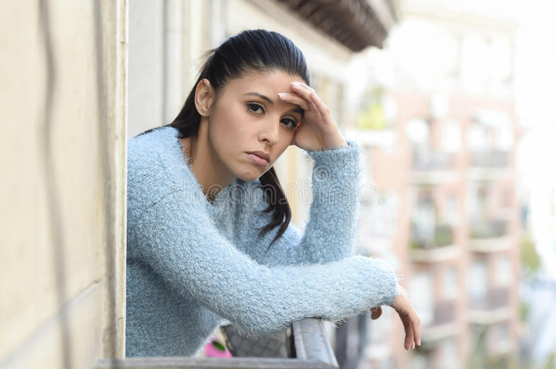 Beautiful sad and desperate hispanic woman suffering depression thoughtful frustrated royalty free stock images