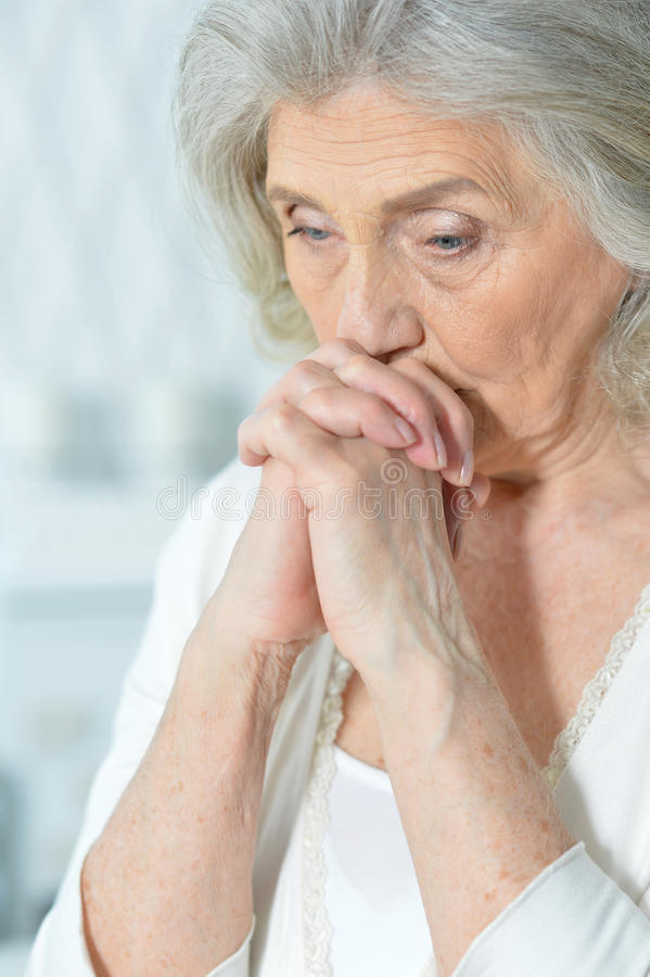 Beautiful sad elderly woman stock photos