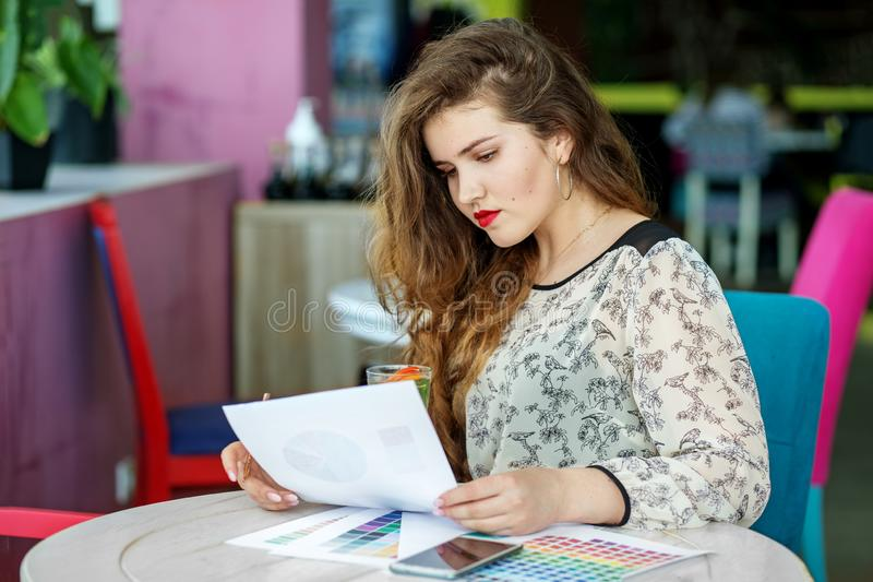 Beautiful sad woman preparing for exams. The concept of work, business, education, freelance, lifestyle.  stock images