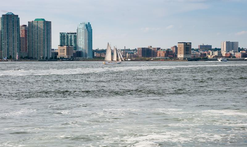 Beautiful sailing ship in Hudson bay, New York. Manhattan`s downtown skyscrapers on background. New York. USA stock photo