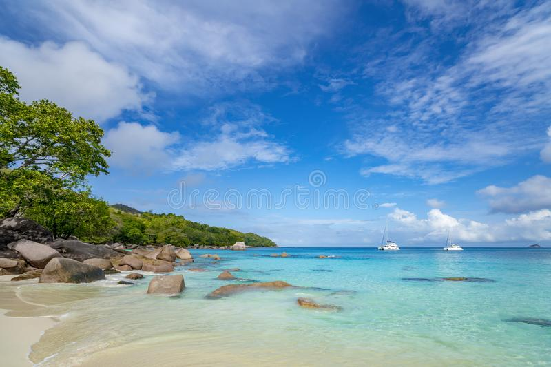 Beautiful sandy beach with  turquoise sea on Seychelles royalty free stock image