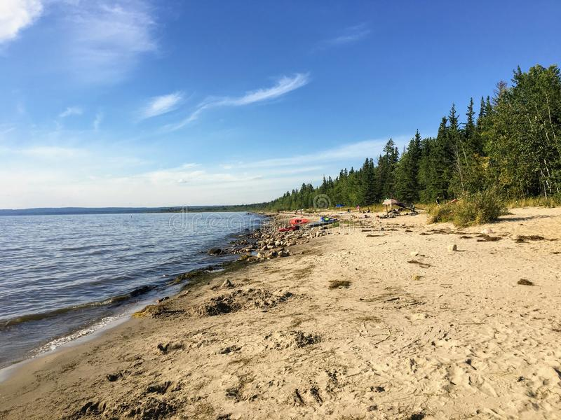 The beautiful sandy beaches along Marten Beach and the waters of slave lake in Northern Alberta, Canada on a warm summer day. royalty free stock images