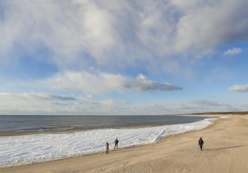 A beautiful sandy winter beach in a sunny afternoon in Palanga, Lithuania stock images