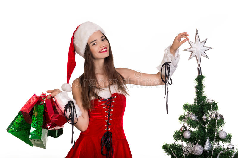 Beautiful Santa Claus woman holding shopping bags stock images