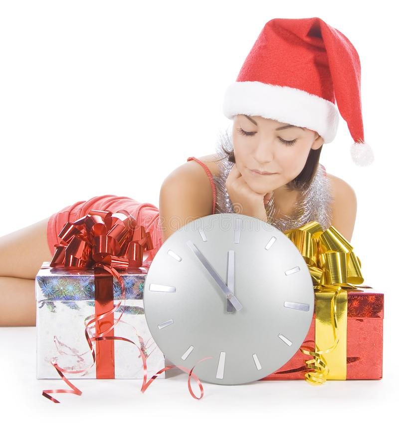 Santa girl with clock waiting midnight royalty free stock image