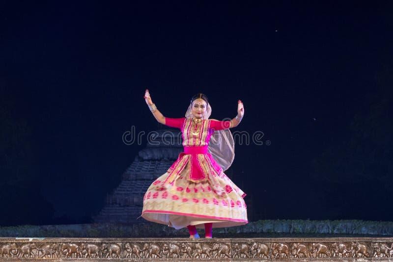 Beautiful Sattriya Dancer performing Sattriya Dance on stage at Konark Temple, Odisha, India..A assamese classical indian dance royalty free stock photography