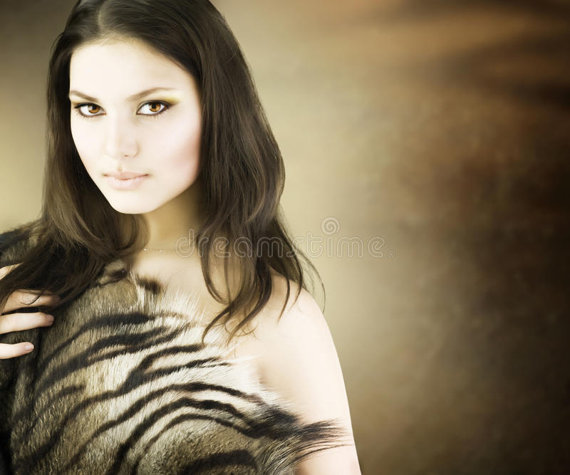 Beautiful Savage Girl portrait. Portrait of Beautiful Wild Girl over blurred background.With copy space stock photo