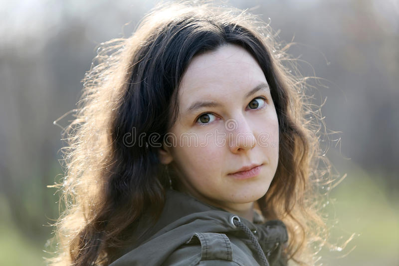 Beautiful scared brunette girl stock image