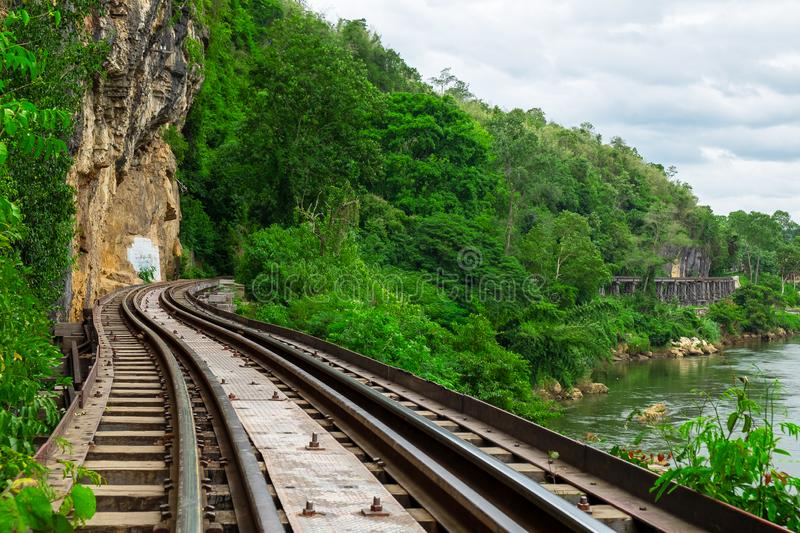 Beautiful Scence of Train Railway through Mountain Forrest and River.  stock photo