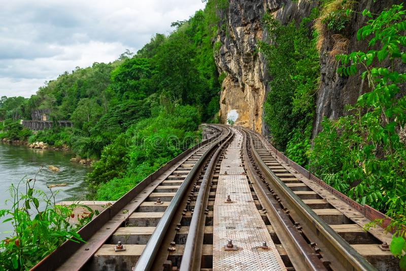 Beautiful Scence of Train Railway through Mountain Forrest and River.  stock images