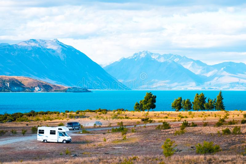 \'Beautiful scene of campervan, car, the yellow grassland mt cook and lake tekapo before sunset. I. \'Beautiful scene of campervan, car, the yellow grassland mt royalty free stock images