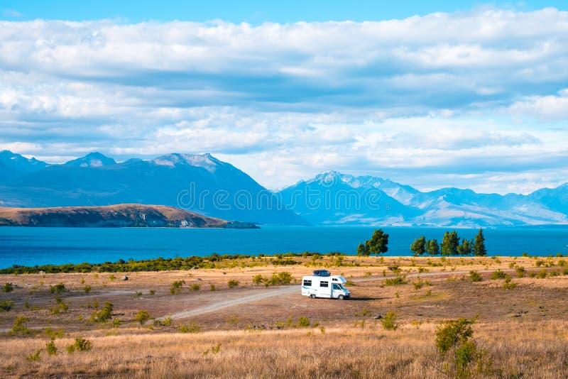 \'Beautiful scene of campervan, car, the yellow grassland mt cook and lake tekapo before sunset. I. \'Beautiful scene of campervan, car, the yellow grassland mt stock photo