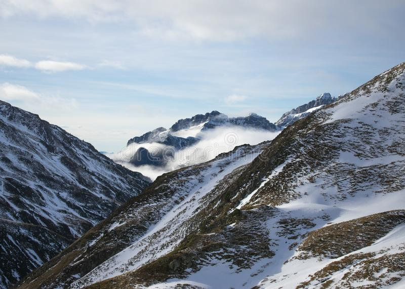 Beautiful scene of cloudy and snowy mountains. stock image
