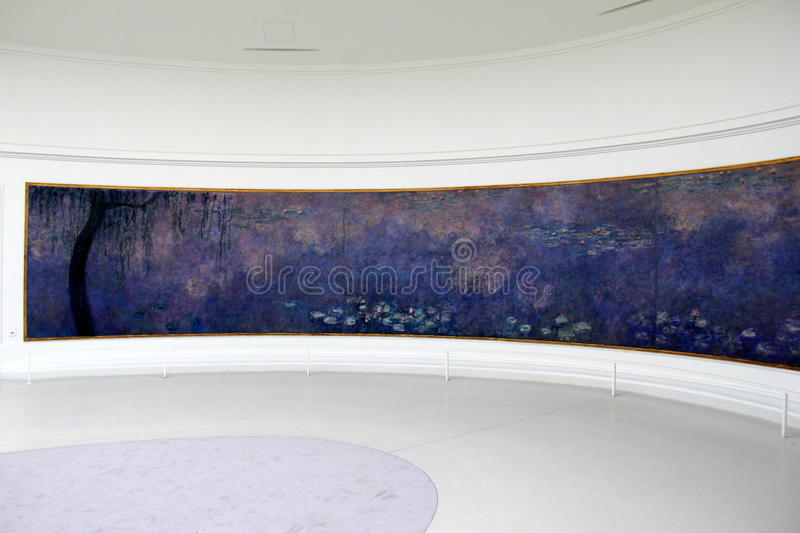 Beautiful scene of curving wall with mural of Monet's 'Water Lilies' Musee de L' Orangerie,Paris,France,2016 royalty free stock photography
