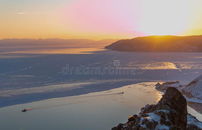 Beautiful scene of Lake Baikal in winter with evening sunset light. Landscape of headwaters area of Lake Baikal in winter season; some area water in lake become stock photography