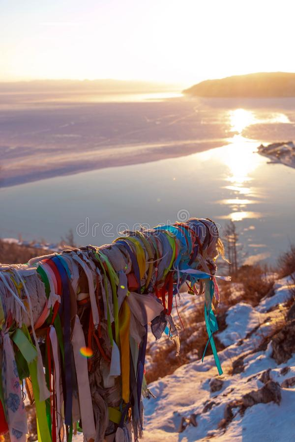 Beautiful scene of Lake Baikal in winter in evening that sunset light reflected in water; and some area become ice. Headwaters of Lake Baikal in evening sunset royalty free stock photography