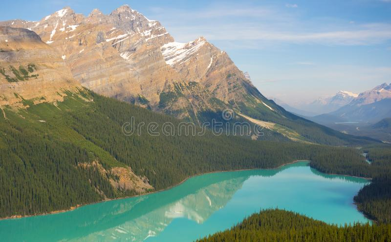 Mountains reflected in a calm lake in the rockies. A beautiful scene of the rockies in the summertime stock photos