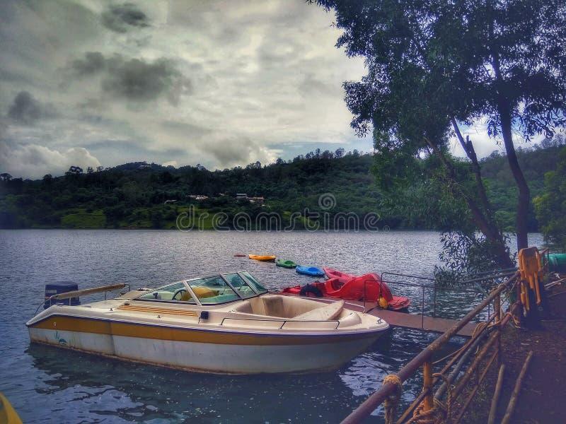 A white boat in panshet lake royalty free stock image