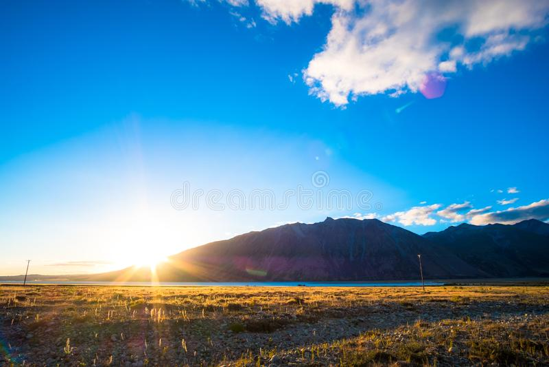 Beautiful scene of the yellow grassland mt cook and lake tekapo before sunset. I. Beautiful scene of the yellow grassland mt cook and lake tekapo before sunset stock photo