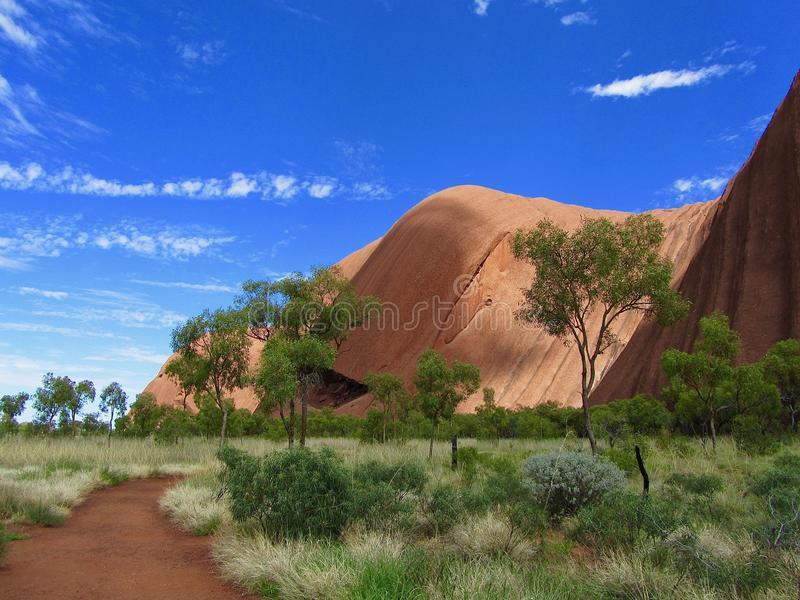 Ayers Rock Uluru in Australia. Beautiful scenery by Ayers Rock close to Uluru in Australia. The rock is sacred to the locals royalty free stock photo