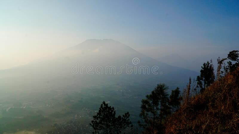 Amazing view on the hill. Beautiful scenery for climbers on Andong Peak in Magelang District, Central Java, Indonesia stock photo