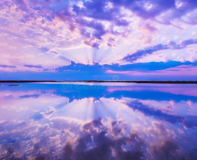 Beautiful scenery with colorful sky, beautiful water reflectioncloud, clouds and sunbeams.Artistic picture. Beauty world. royalty free stock photos