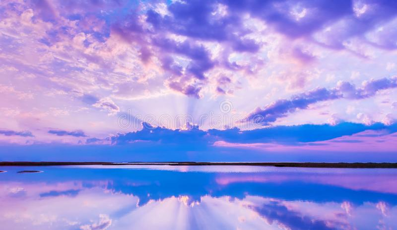 Beautiful scenery with colorful sky, beautiful water reflectioncloud, clouds and sunbeams.Artistic picture. Beauty world. Panorama royalty free stock images