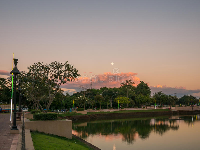 Beautiful scenery of lake and full moon in buriram, Thailand. Beautiful scenery of lake and full moon in a park in buriram, Thailand stock photography