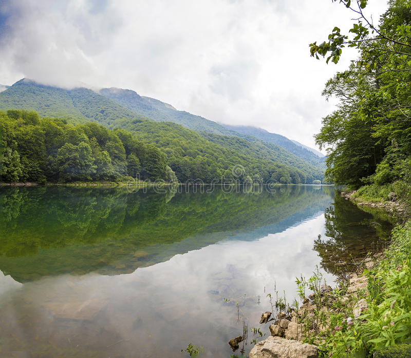 Beautiful scenery of the mountains and the lake stock image image download beautiful scenery of the mountains and the lake stock image image of time voltagebd Images