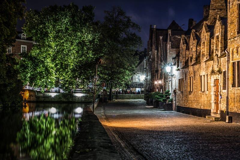 Neighborhood by night stock image. Image of parking, house