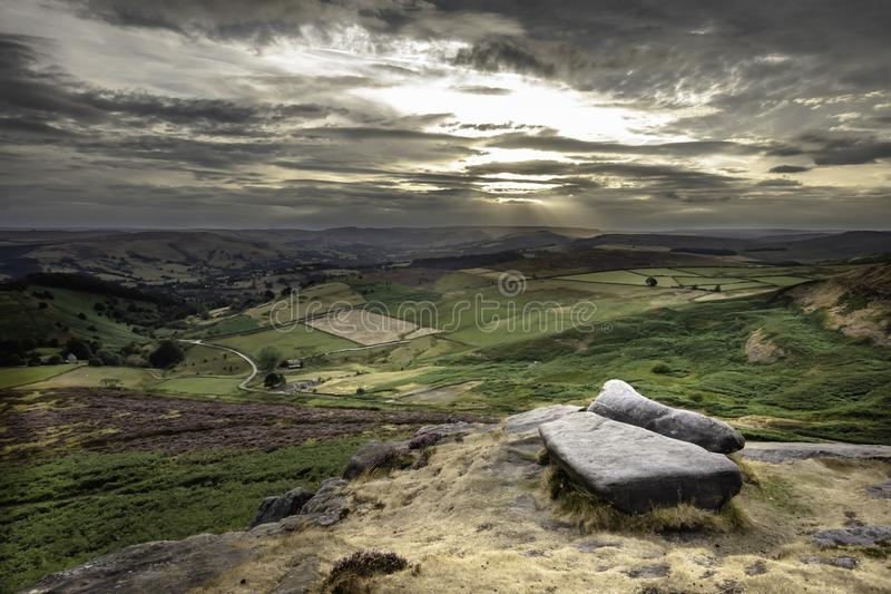 Beautiful scenery of Peak District National Park, Derbyshire, Uk. Dramatic sky over scenic valley with fields and hills during sunset in Peak District National stock photos
