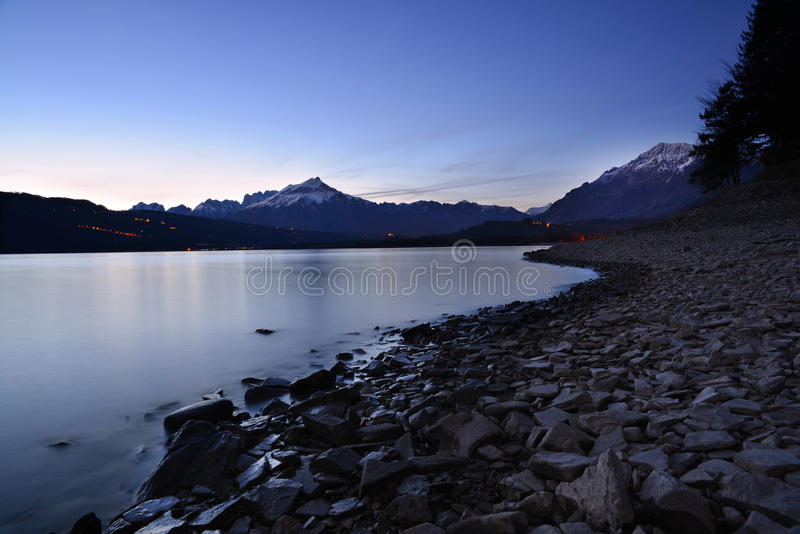 Quiet night by the lake. A beautiful scenery and a really quiet night spent by the lake royalty free stock image