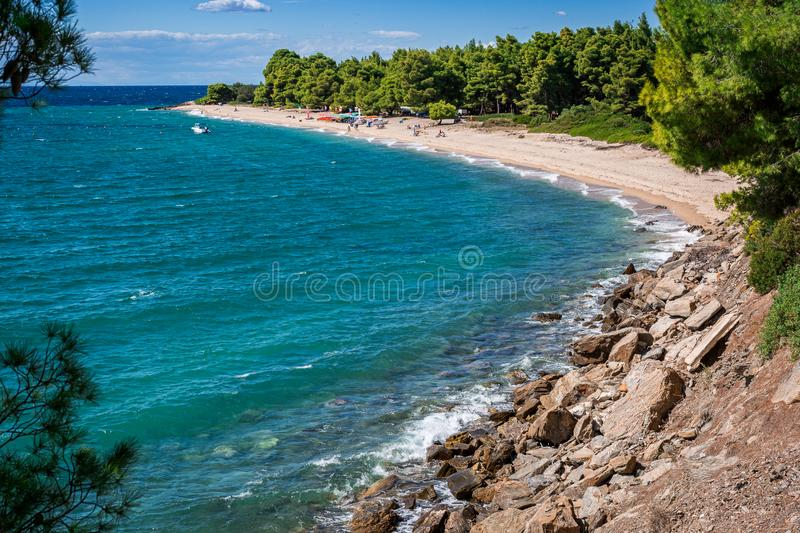 Scenery seascape on Halkidiki peninsula, Greece. Sandy beach with green pines. Travel and summer vacation concept. Beautiful scenery seascape on Halkidiki royalty free stock photography