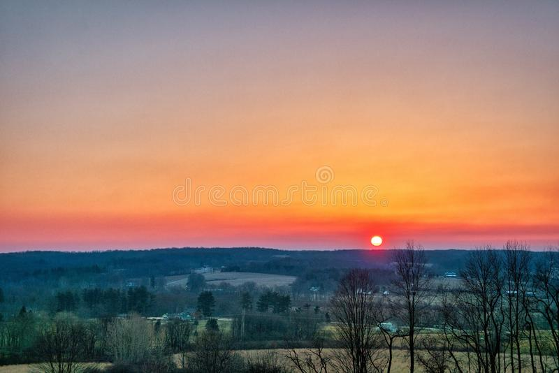 Beautiful scenery of the sunrise in the countryside of Northwest Pennsylvania. The beautiful scenery of the sunrise in the countryside of Northwest Pennsylvania stock image