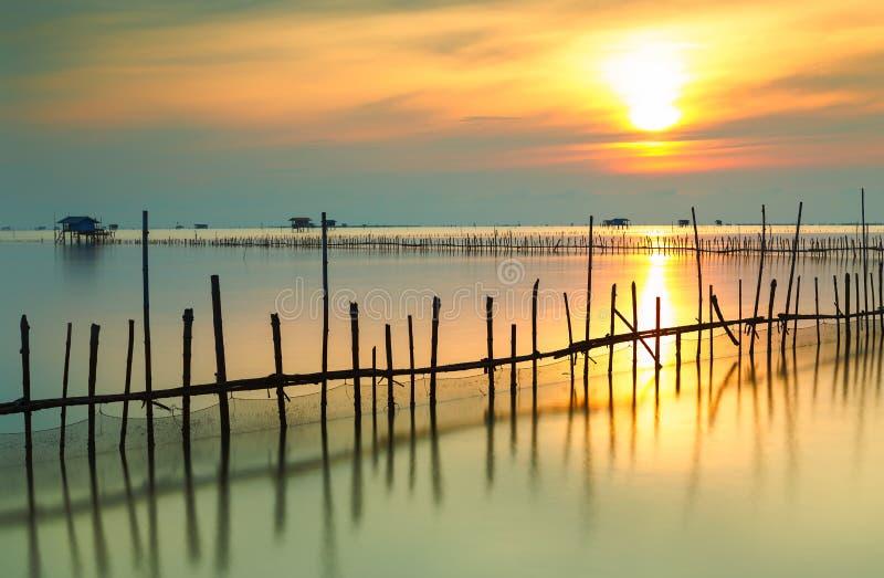Beautiful scenery of sunrise in the morning at Bangtaboon Bay,Phetchaburi,Thailand royalty free stock images