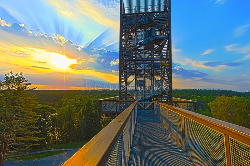 Beautiful scenery of sunset at the end of summer. Above the forest and river at Anyksciu park in Lithuania. Walking foot-bridge above treetops stock image