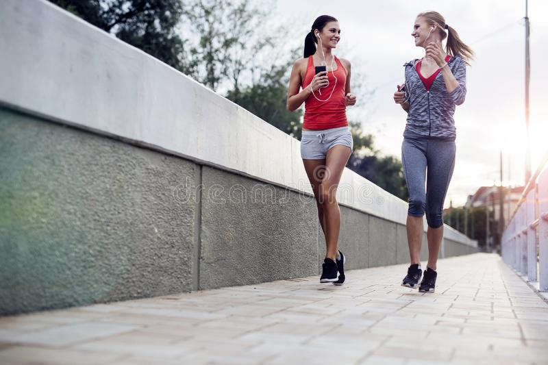 Beautiful scenery of two female joggers stock photography
