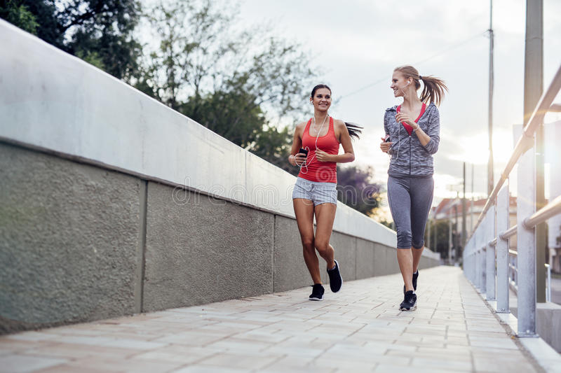 Beautiful scenery of two female joggers royalty free stock photos