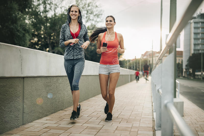 Beautiful scenery of two female joggers royalty free stock photo