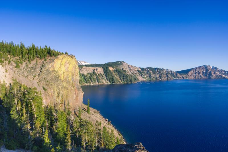 Beautiful scenery of the volcanic cliff as seen from the north rim in Crater Lake, royalty free stock photo