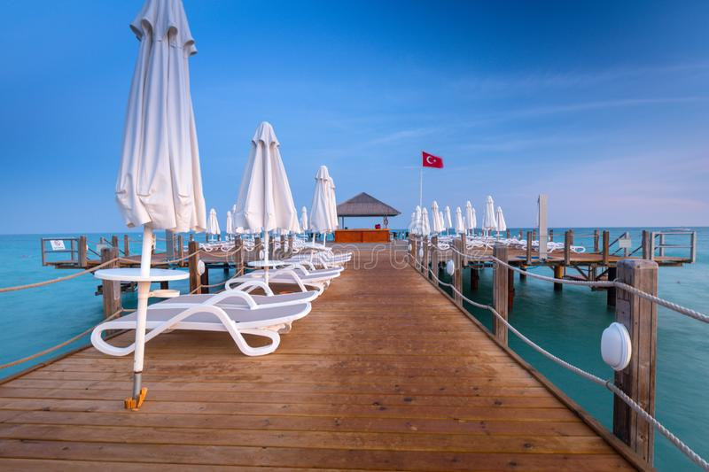Beautiful scenery with wooden pier on Turkish Riviera at sunset, Side royalty free stock images