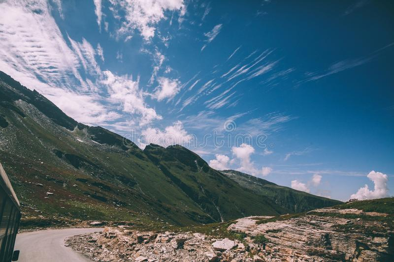 beautiful scenic mountain landscape and road with vehicle in Indian Himalayas, Rohtang stock images