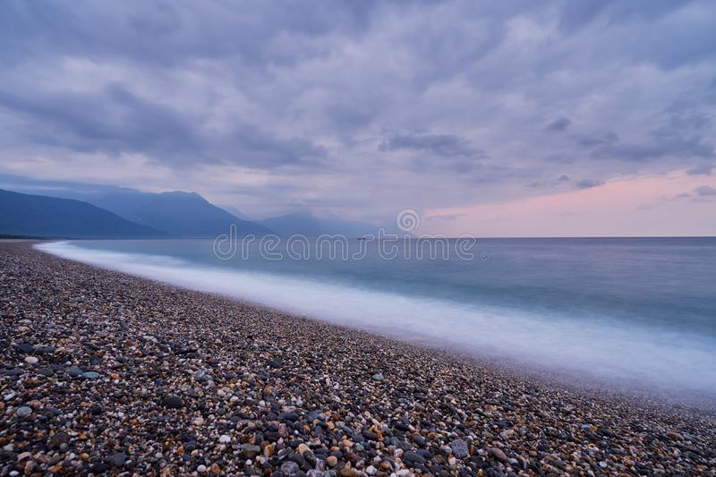 Beautiful scenic of ocean with sprawling stone covered beach at Qixingtan beach royalty free stock photos