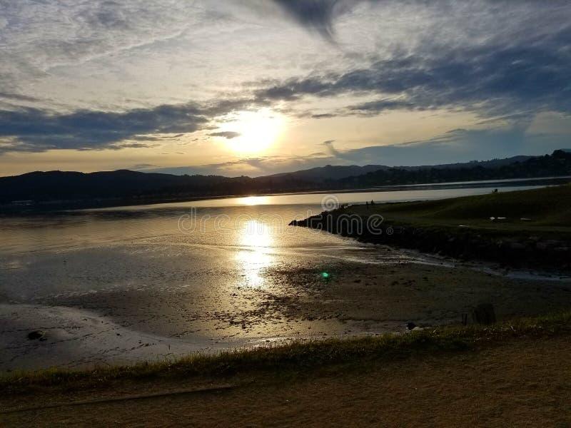 Sunset over sandy beach royalty free stock photo