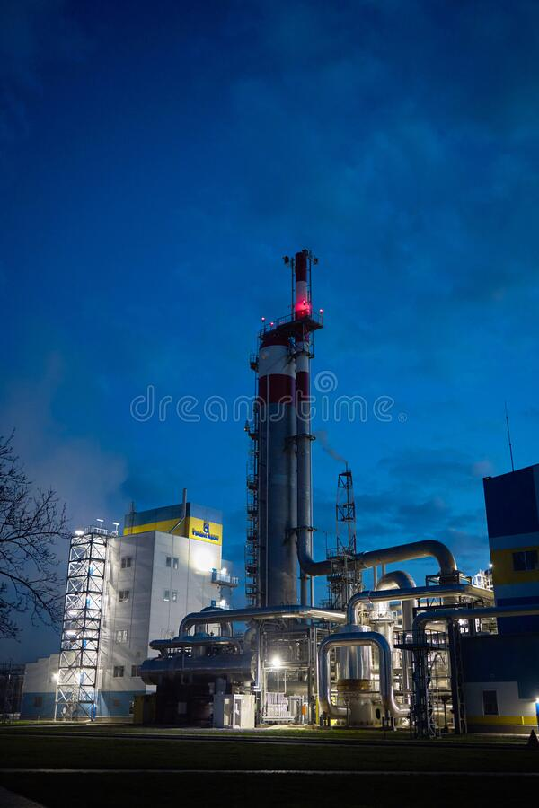 Beautiful scenic of petrochemical oil refinery plant shines with red and white lights at night with and copy space vertical.  royalty free stock images
