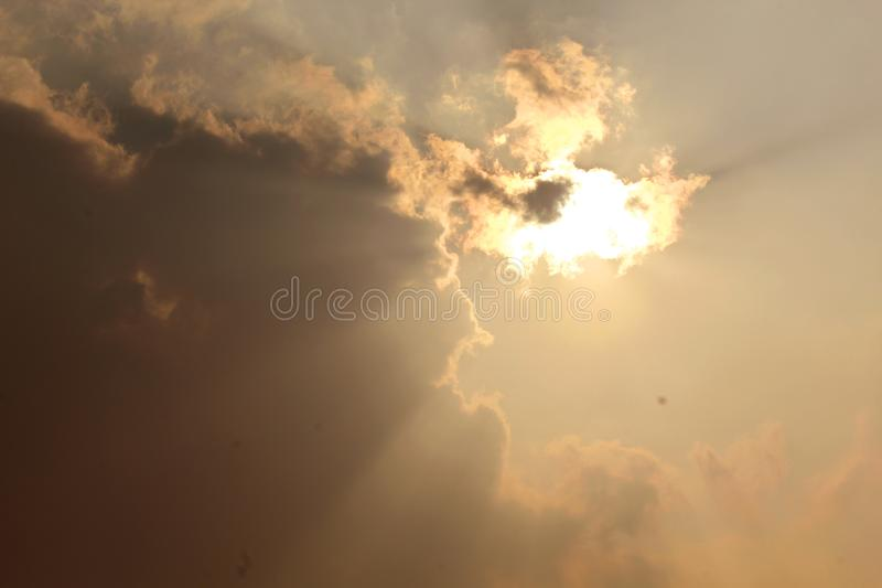 Beautiful scenic sunset with sun peeping out from behind the cloud. A environmental natural photo royalty free stock photo
